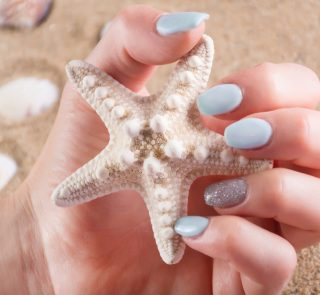 5 Vacation Nail Polish Colors That Will Make You Dream of Sand and Sun