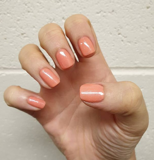 Coral-Colored Nails With Shimmer